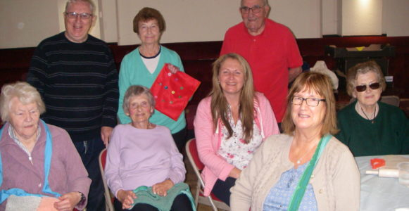 Group Image of Craft Club with Louise from NGNPUK showing off their handmade syringe bags