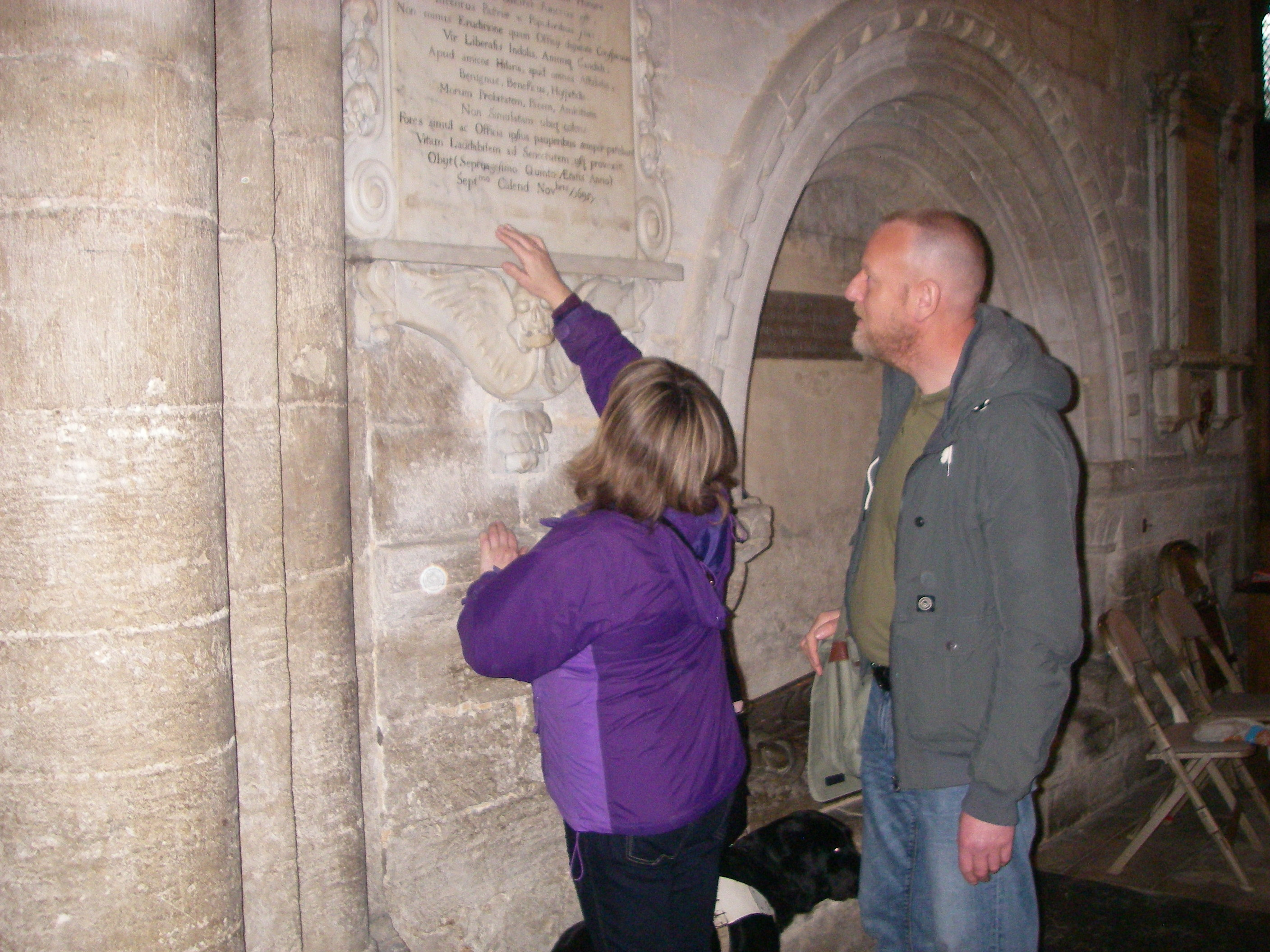 PAB Member Feeling an Inscription on the Cathedral Wall