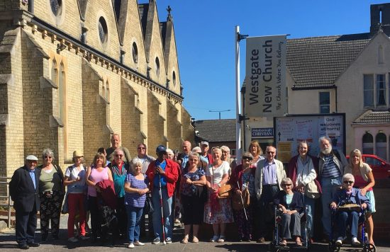 Image of PAB members and friends stood in a large group outside Old Westgate Church