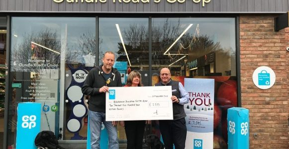 Image of PAB Trustees being awarded a giant cheque outside of the co-op store on oundle road, peterborough